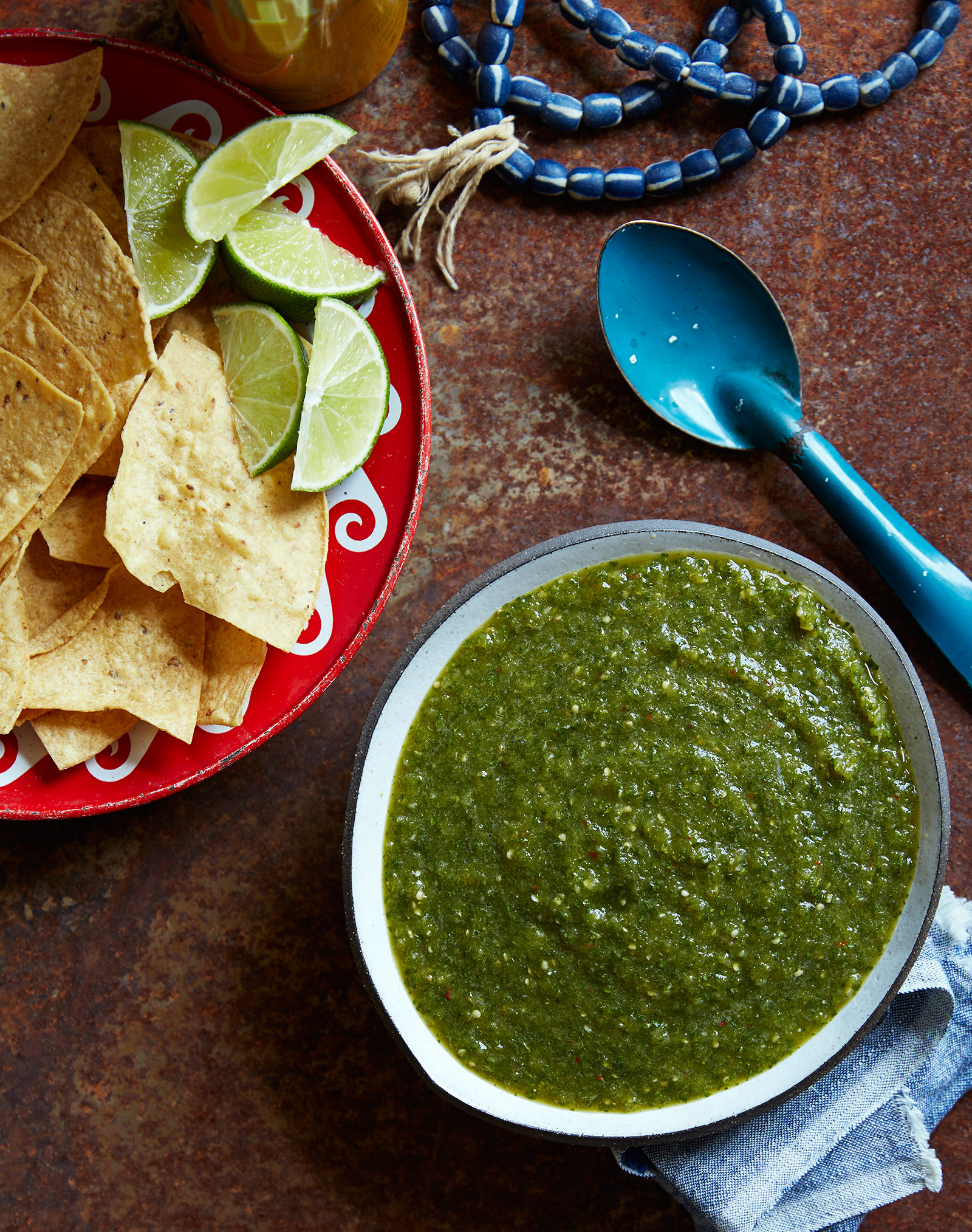 tomatillo kimchi salsa with corn tortilla chips and lime