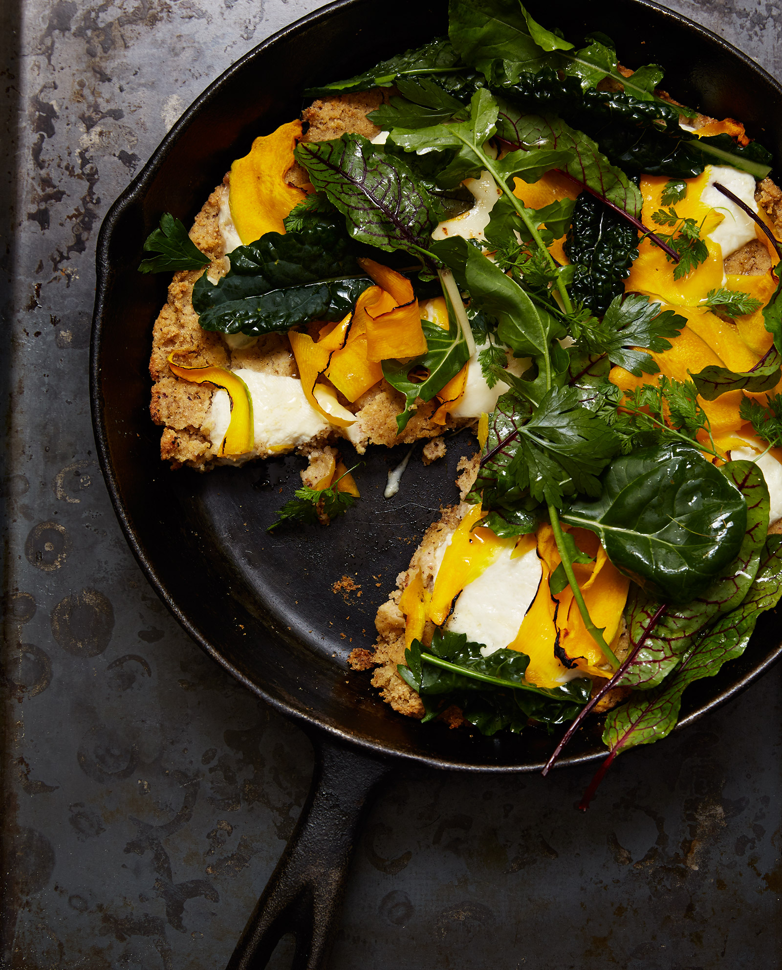 gluten free cast iron pan with skillet flatbread with squash, greens, and burrata pizza