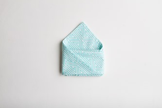 Easter Dinner Napkin fold blue and white cloth