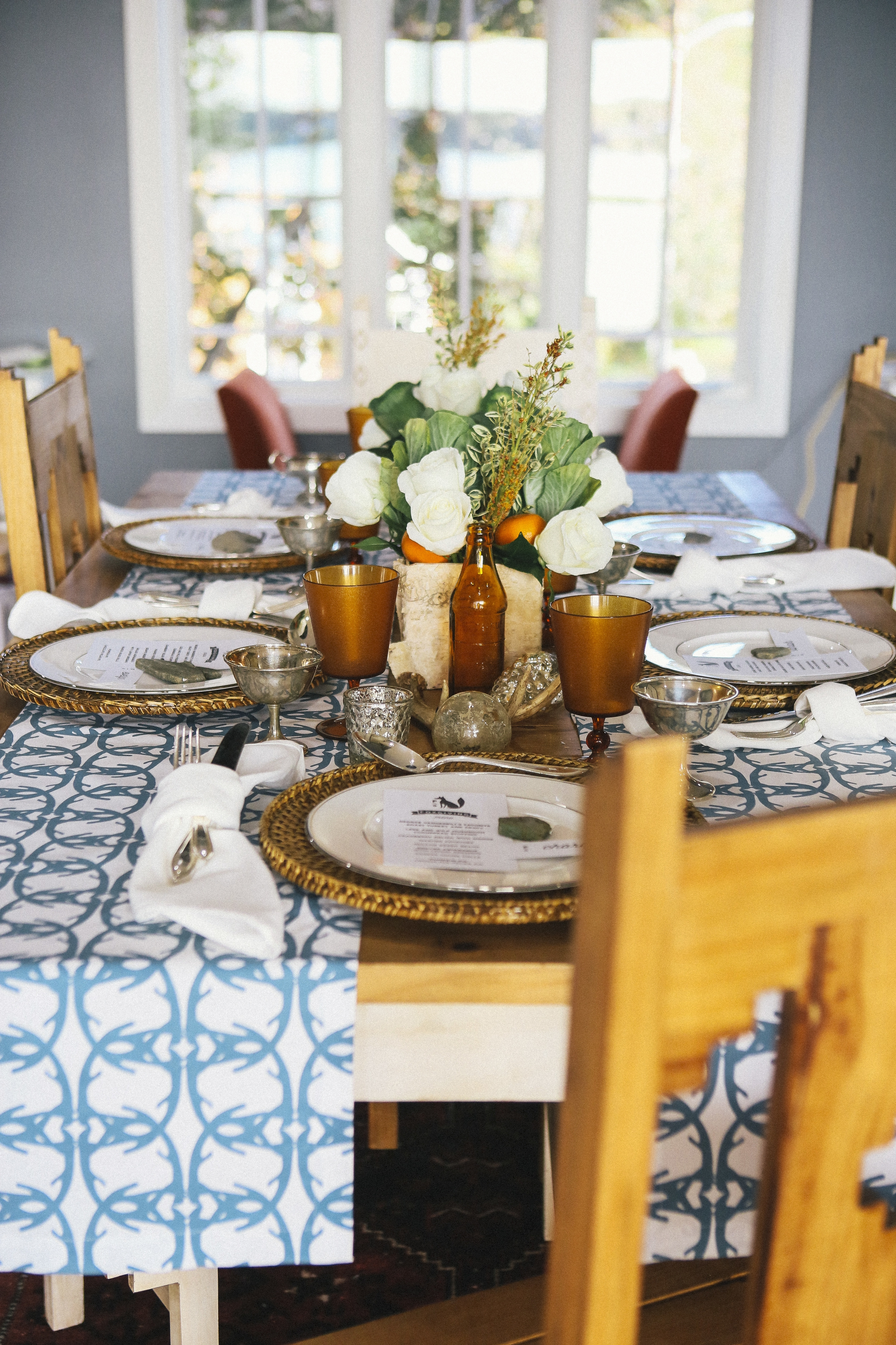"a rustic tablescape composed of ""foraged"" items from around the house"