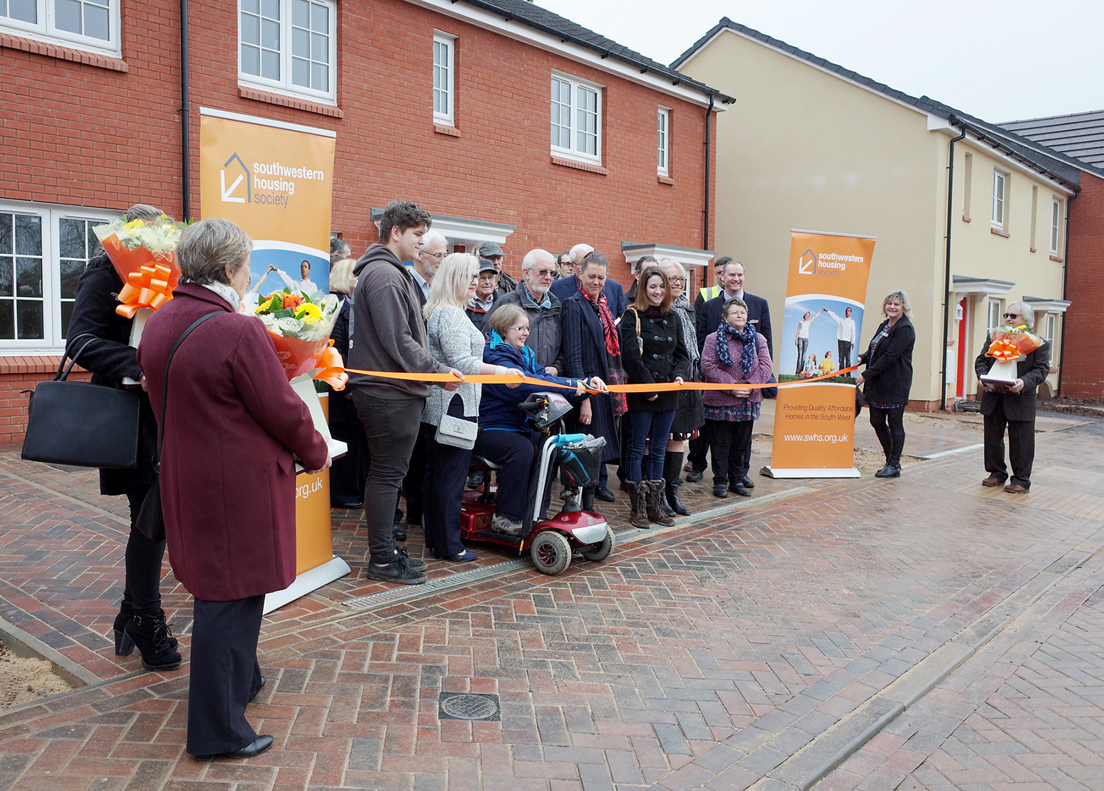 Tenants cutting the ribbon to their new homes in Coltford St Luke