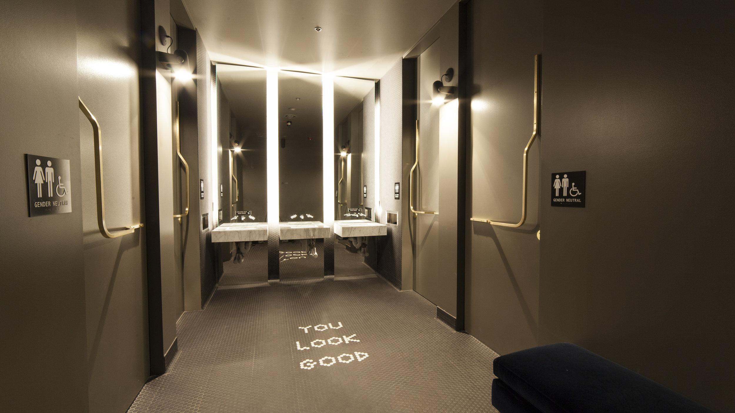Nightcap Ann Arbor bar interior design and gender neutral restrooms by Synecdoche Design Studio