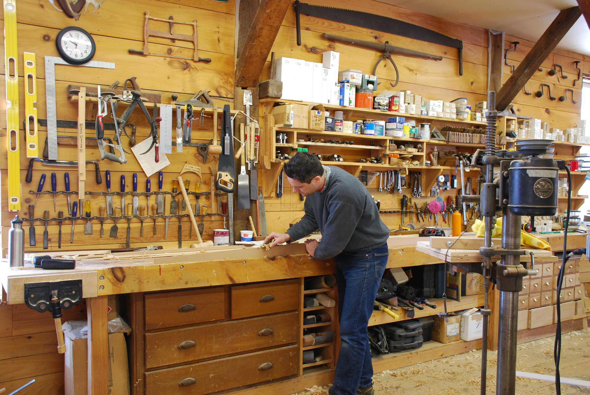 Dylan shaping a section of the goring at the work bench.