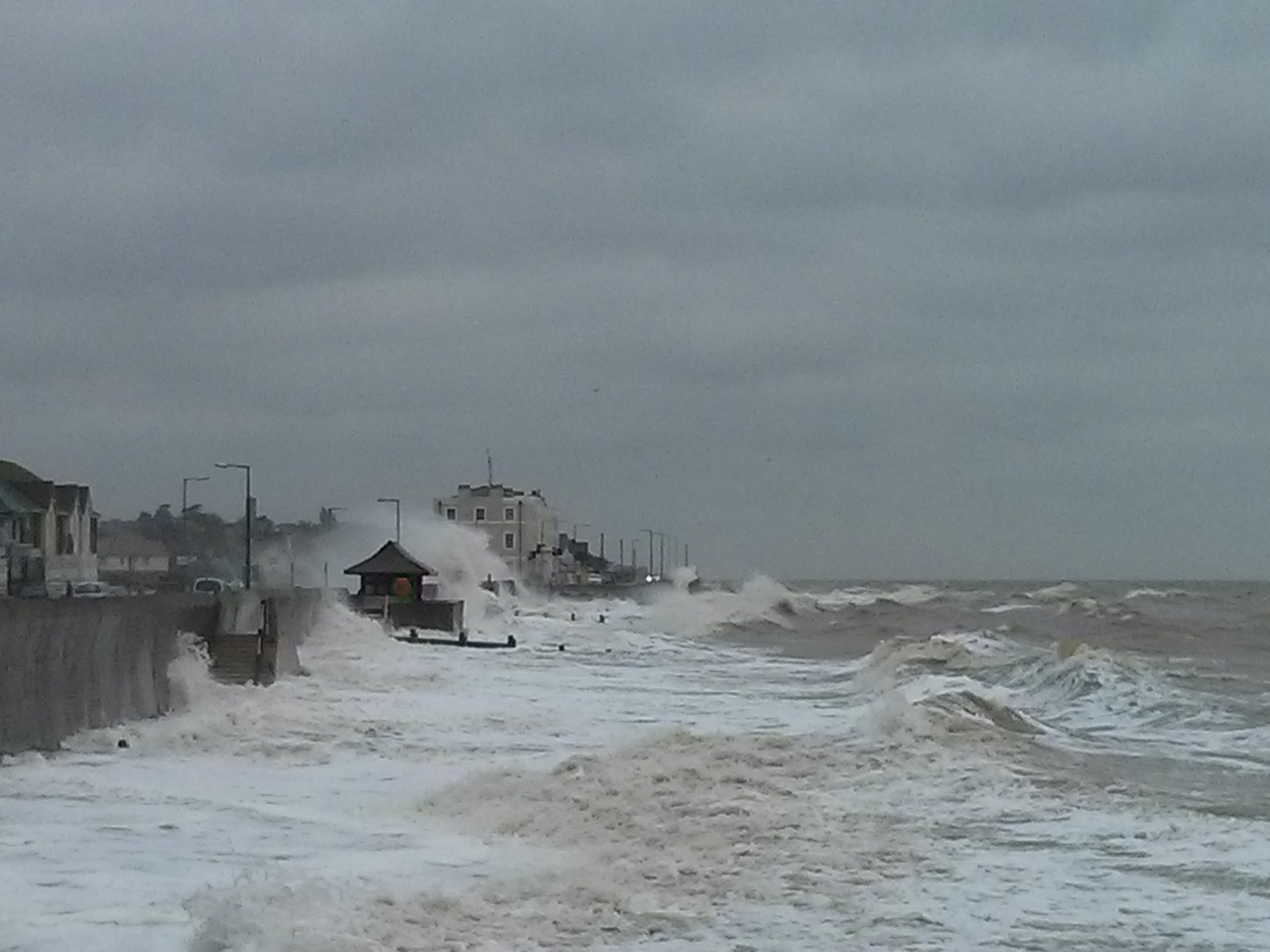 Rough seas breaking over the road this morning at Walton.