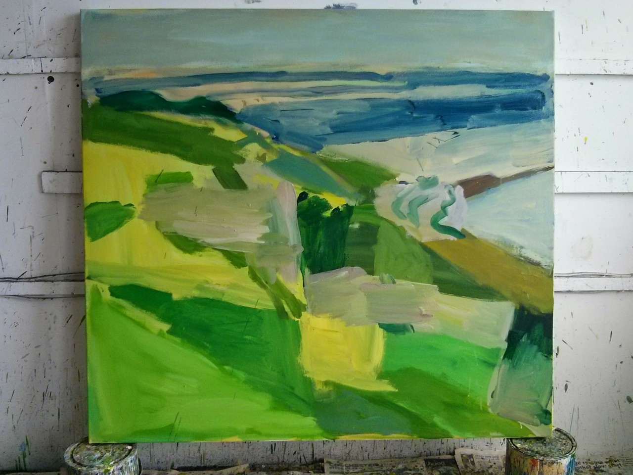 Early state of the new canvas I'm working on; The slopes down to the sea full of lime green Alexanders and big cloud shadows moving out towards the horizon.