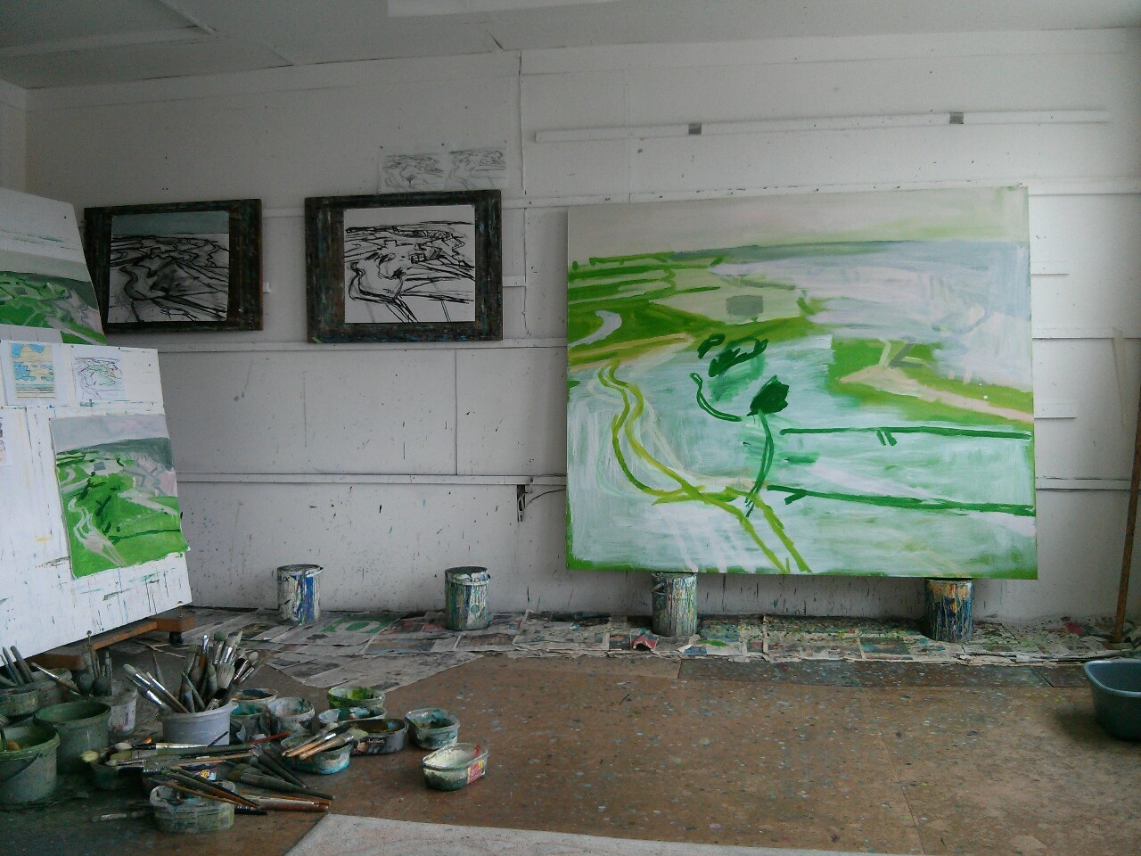 I was out again this morning making some drawings looking out over the seawalls and marshes. I've started another charcoal drawing in the studio and have been making alterations to the canvas, still looking for the big idea that will hold it all together. I have just mixed a jar of cool milky green with which to block in the lower half of the canvas… again.