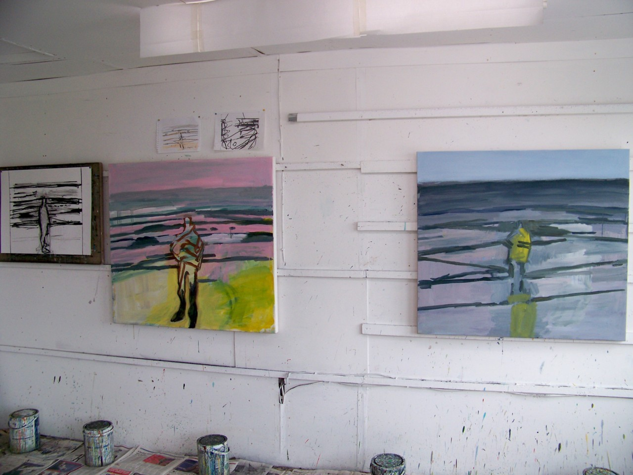 4th May 2012. The studio this morning. Yesterday I was making drawings of two people fishing from the beach; the painting on the right has been adjusted to include one of them. I have put the figure back in the pink painting on the left after discussing the current work with Stephen Walton earlier this week.