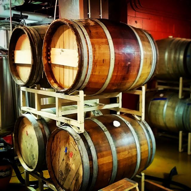 Fermentation and aging in reused oak wine barrels.