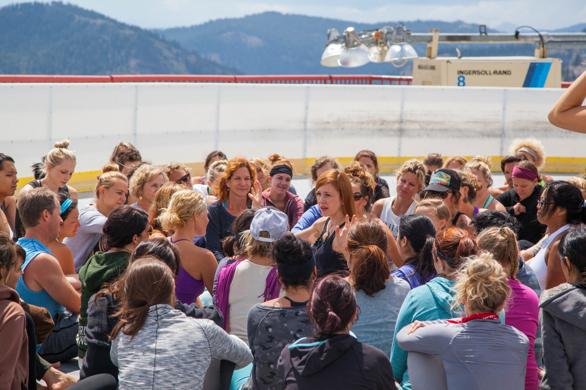 HANNAHtalks with pupils after our yoga class in the ice rink atop the mountain.