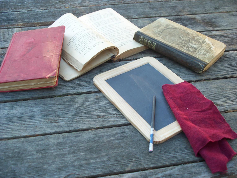 Slate, slate pencil and schoolbooks