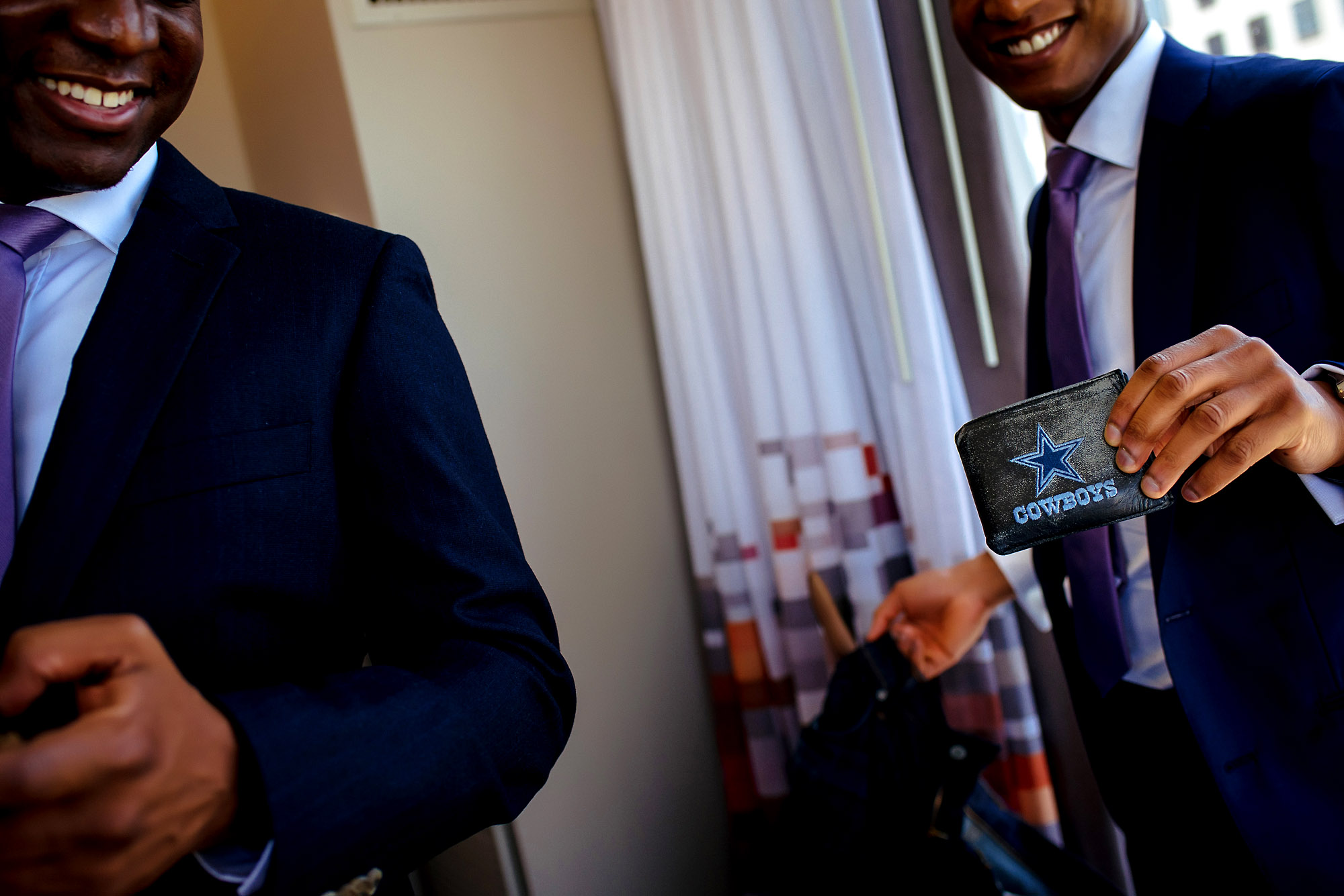 groom showing Dallas cowboys wallet.jpg