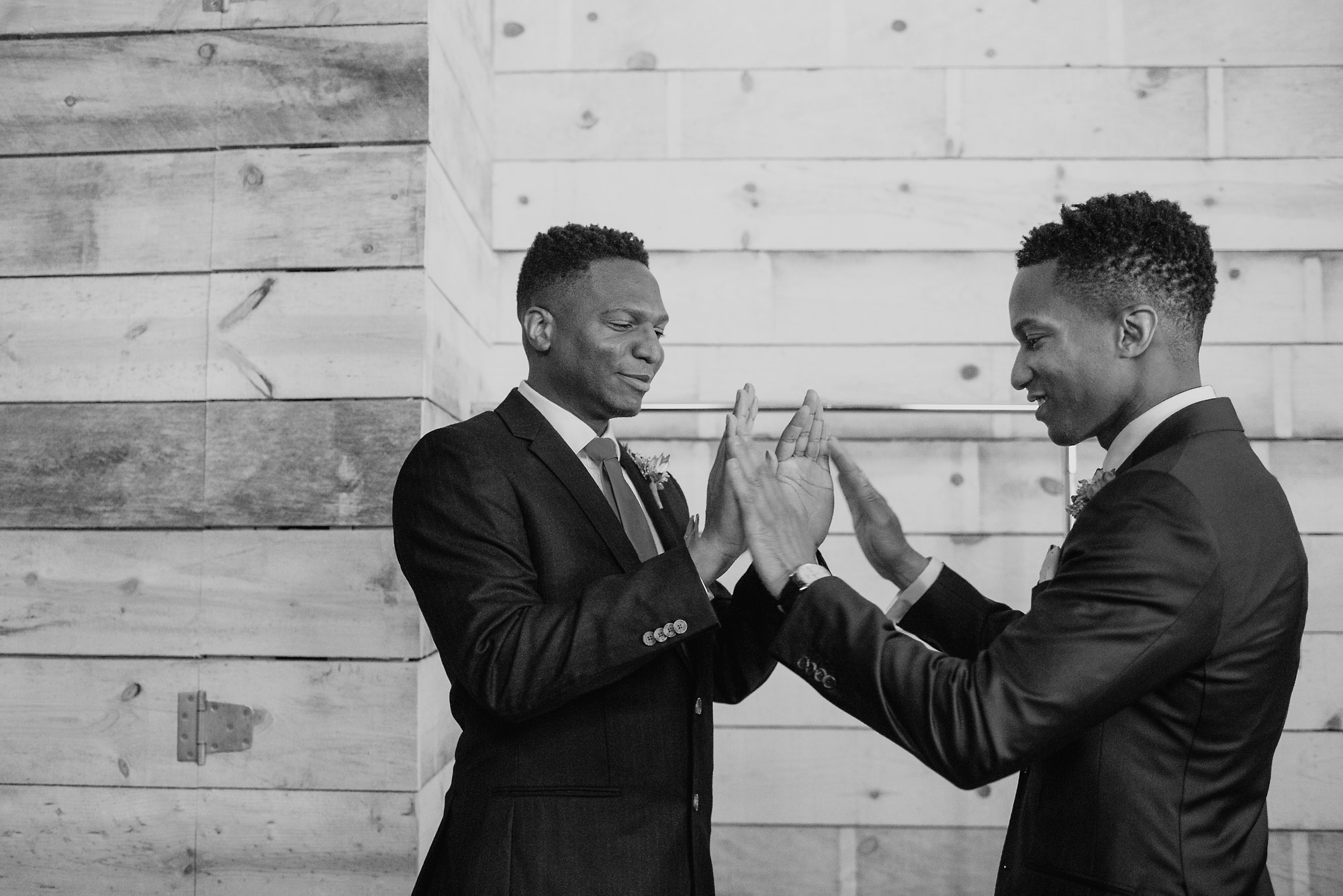 groom and bestman doing a handclap.jpg