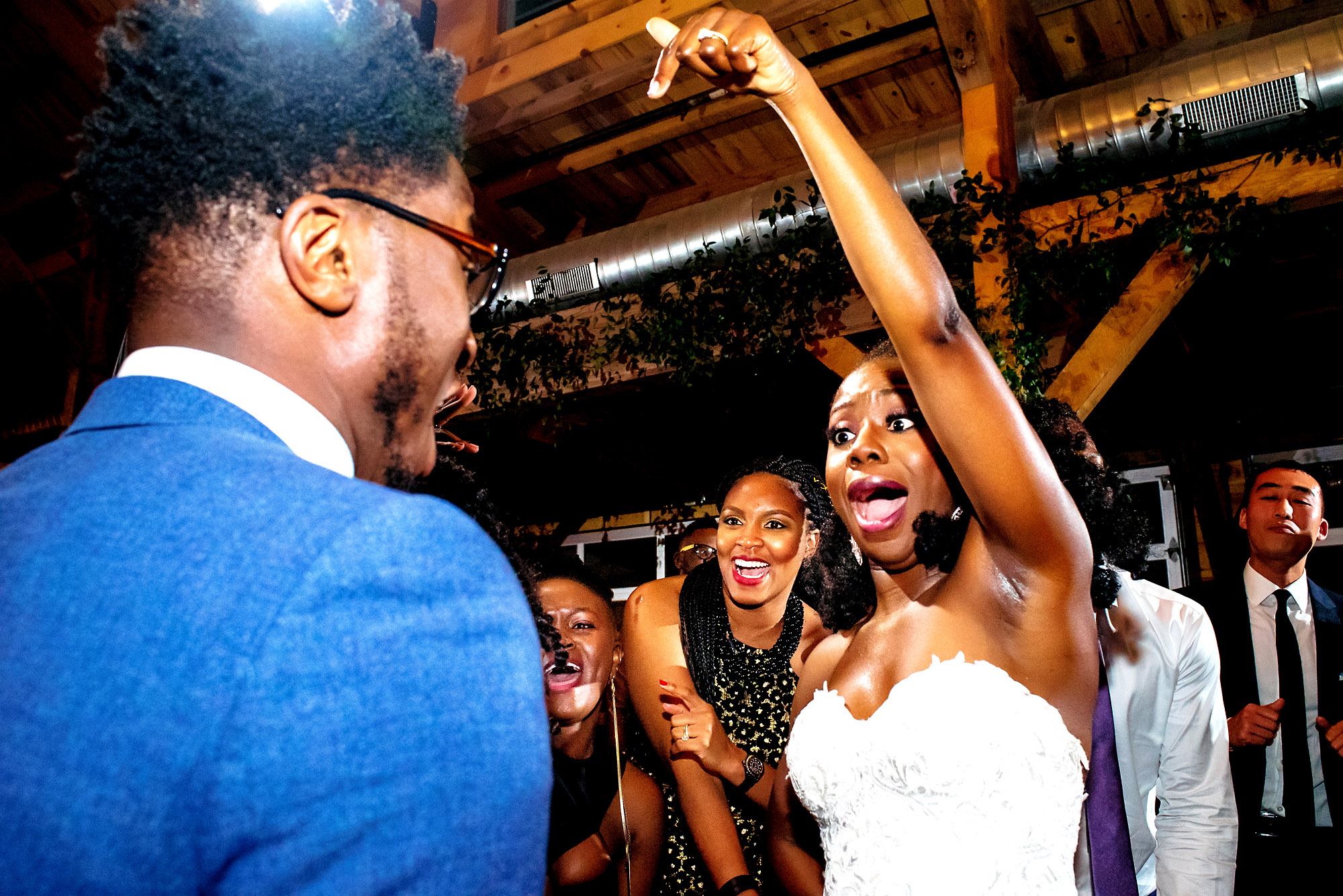 bride jumping with hands pointed to guest.jpg