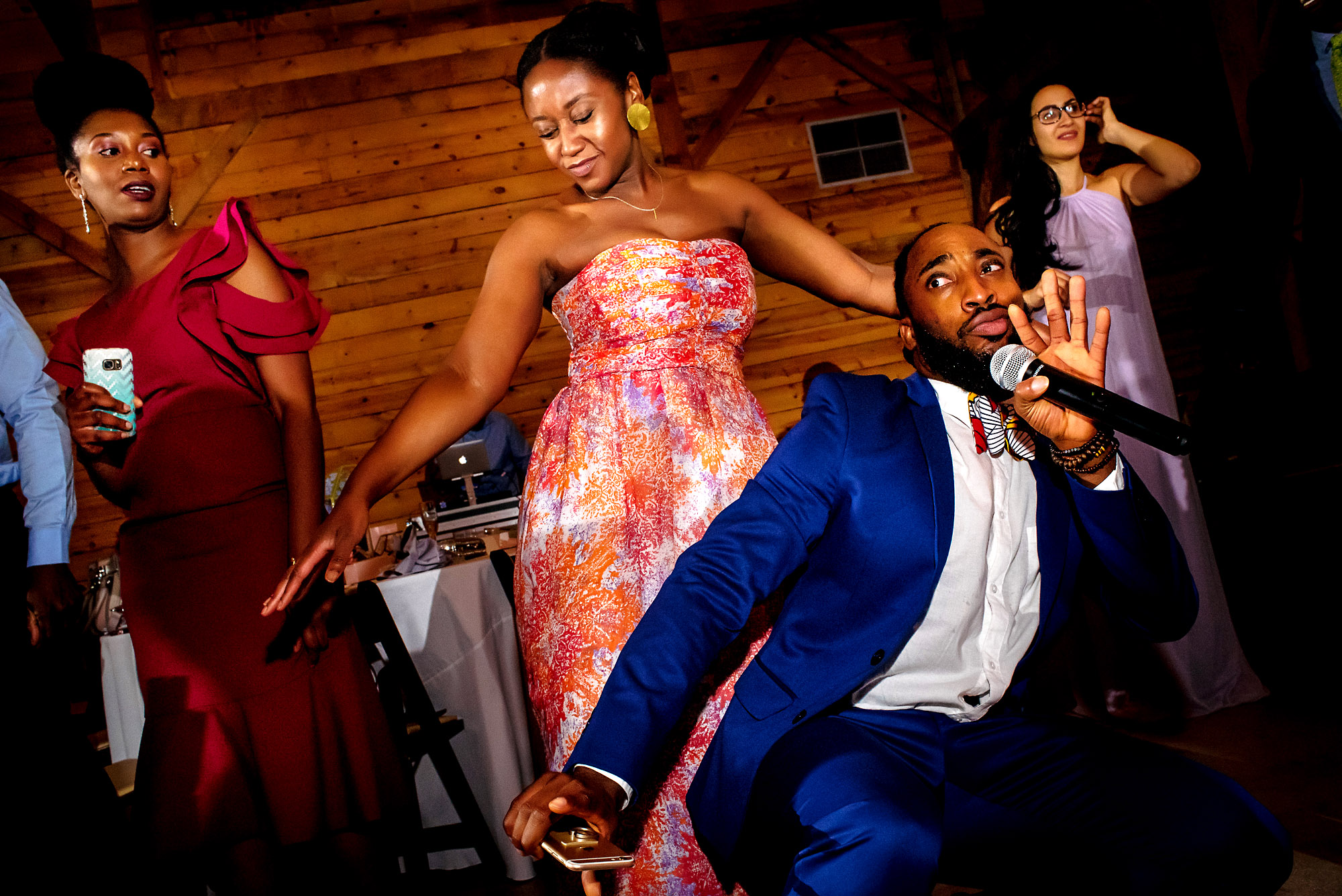 master of ceremony backing up into a guest on the dancefloor.jpg