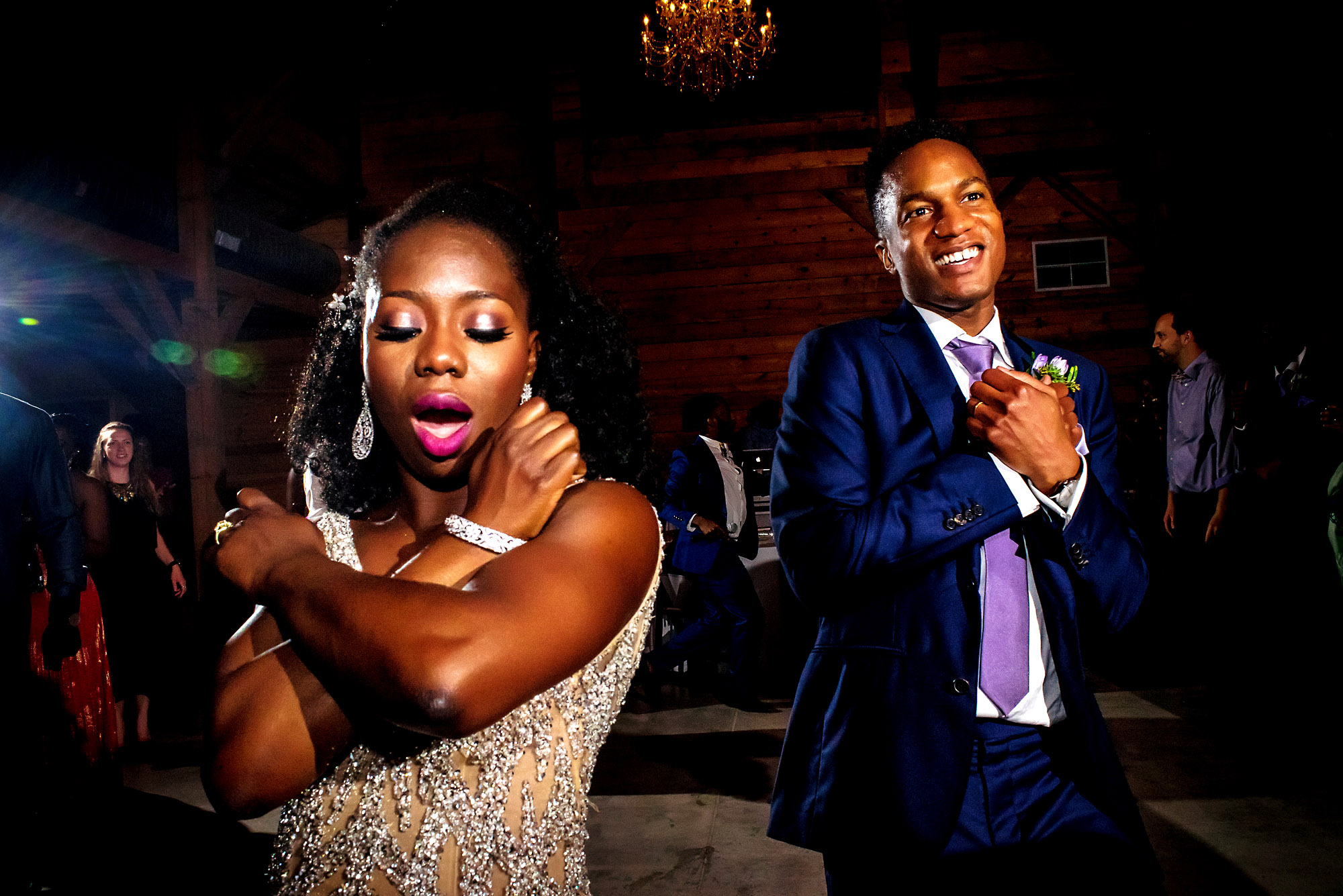 bride and groom doing the wakanda sign on the dance floor.jpg