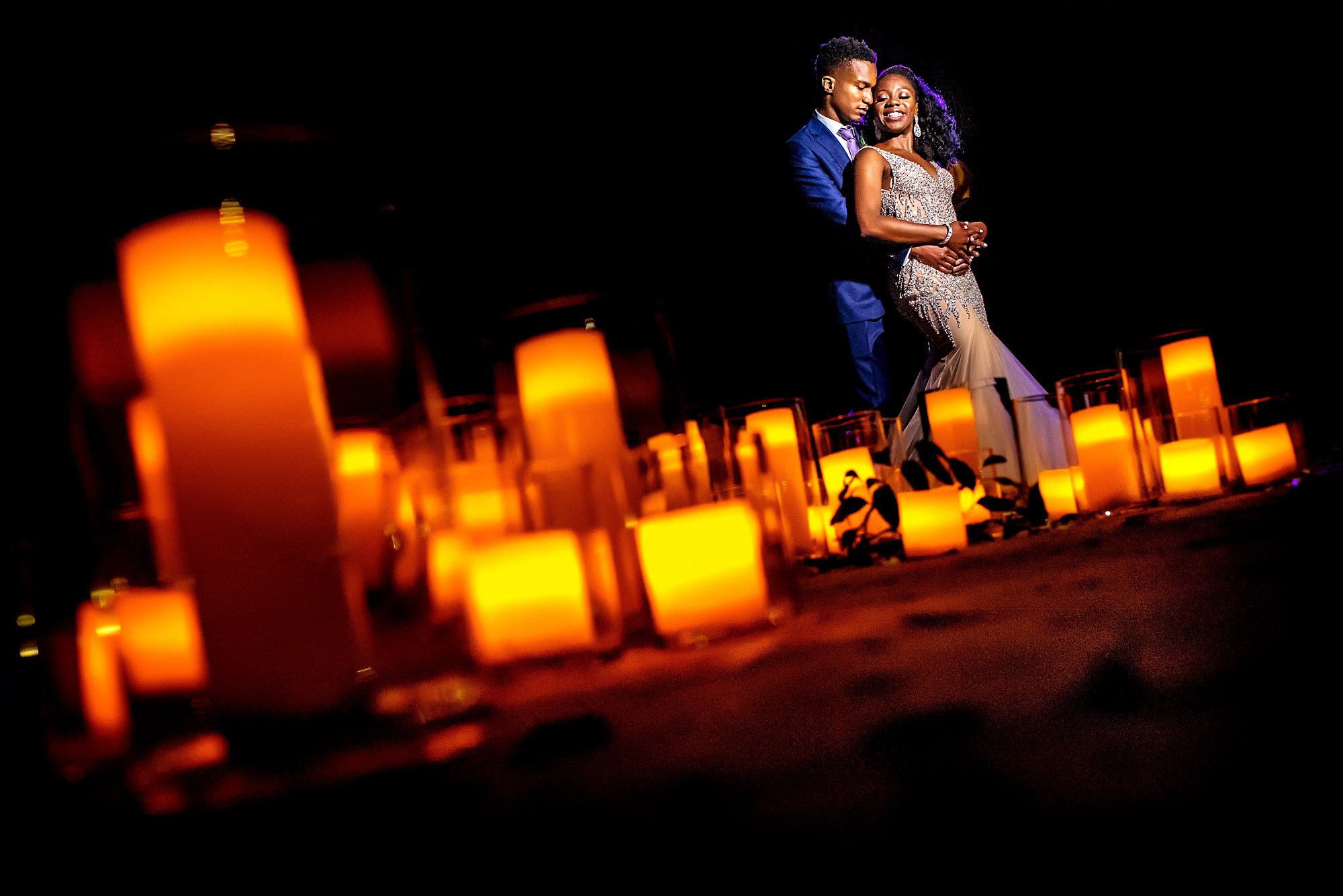 couples portrait with candles in the foreground.jpg