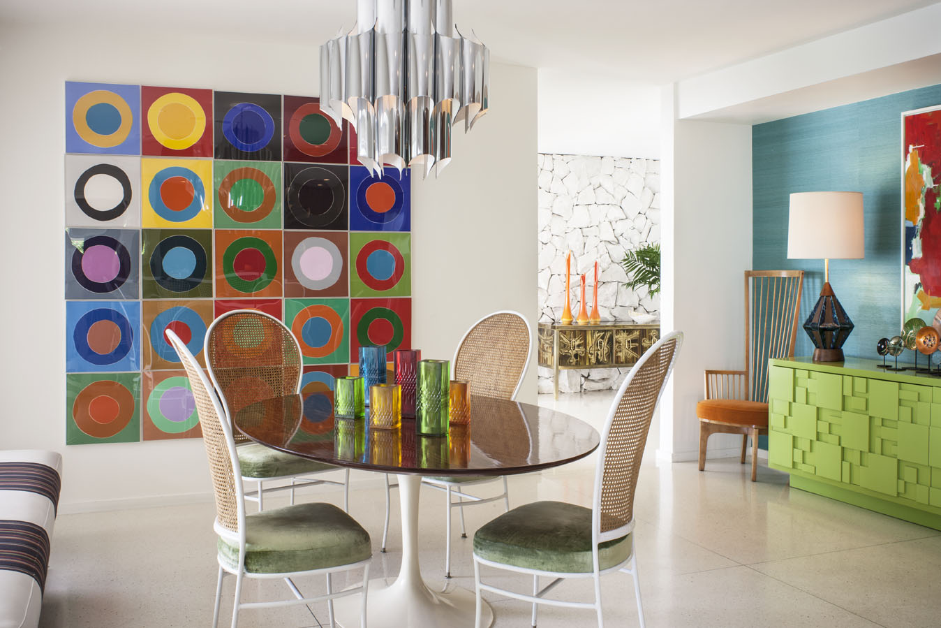 A vibrant midcentury-inspired dining room in Thunderbird Heights image credit: Grey Crawford