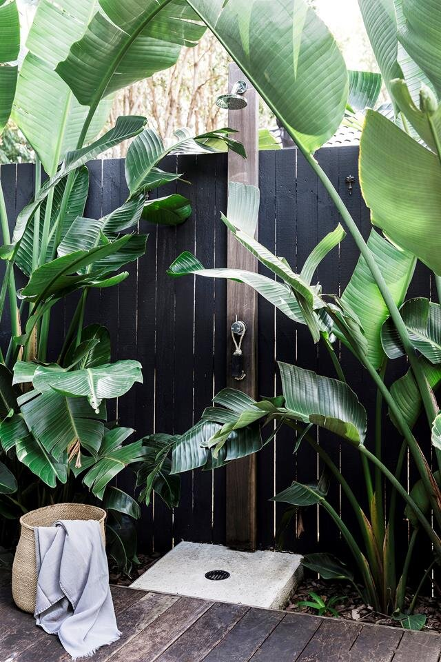 10. Make It Lush - Embrace your natural surroundings by incorporating greenery. Showering outdoors surrounded by palm leaves and foliage will make you feel like you're on a tropical vacation.