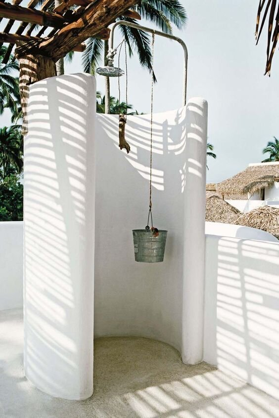 3. Architecturally Unique - Sculptural walls, thatched roof, high shower head. Make your outdoor shower a spectacle to be enjoyed by the body and mind.