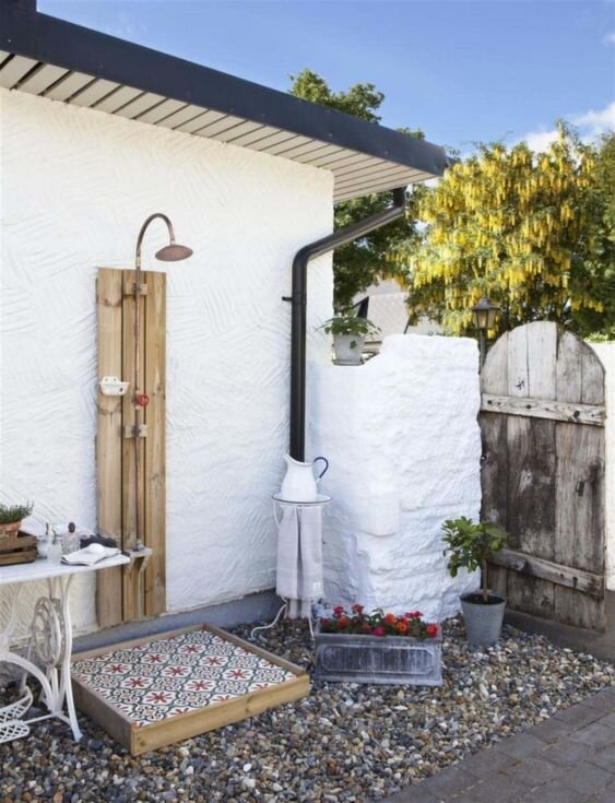 9. Incorporate Fun Tiles - Add special design details and a pop of color by incorporating unique Spanish tiles into the design of your outdoor shower.