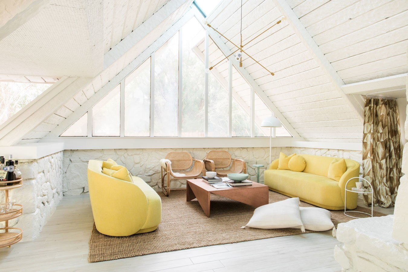 Yellow  Kim Salmela  sofas in the A-frame Loft. Upholstered in  Kravet's Crypton Home Beacon fabric in Lemon .  photo: Jayden Lee