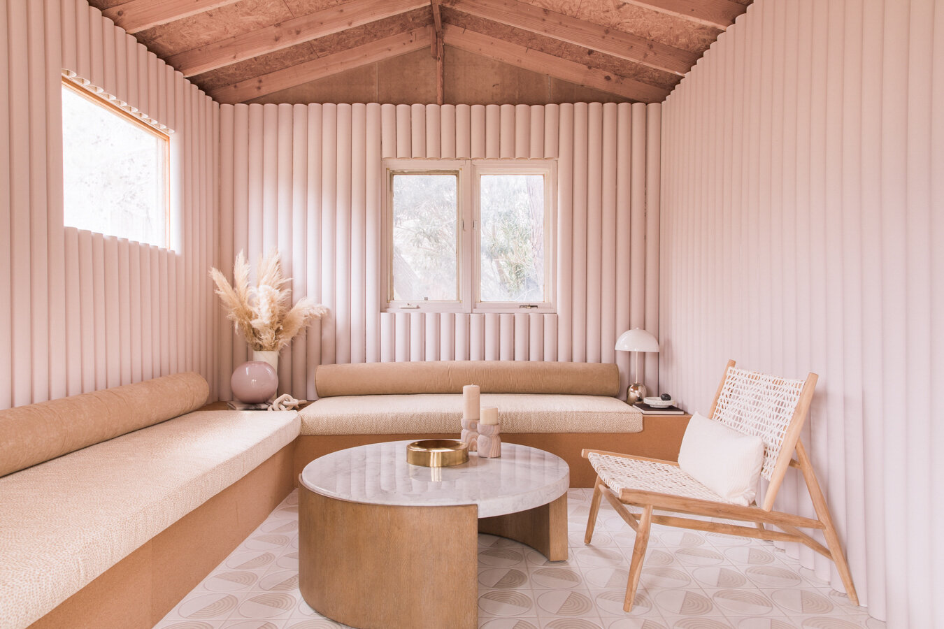 This remodeled PVC Studio was completely reimagined. Check out the complete remodel with more before and after's  on Caroline's blog.   Tile:   Terrain in White Motif from Fireclay   Cushions on Built-in Sofas made by Calico Corners:  bench seat:  Kravet x Crypton Design 34971 – 4 , bolster cushion:  Crypton Home Suede in Harlow   Chairs:   Safavieh Bandelier Off-White Natural Leather Accent Chair from Home Depot   Designed in Collaboration with Anne Sage. Photos:  Jayden Lee