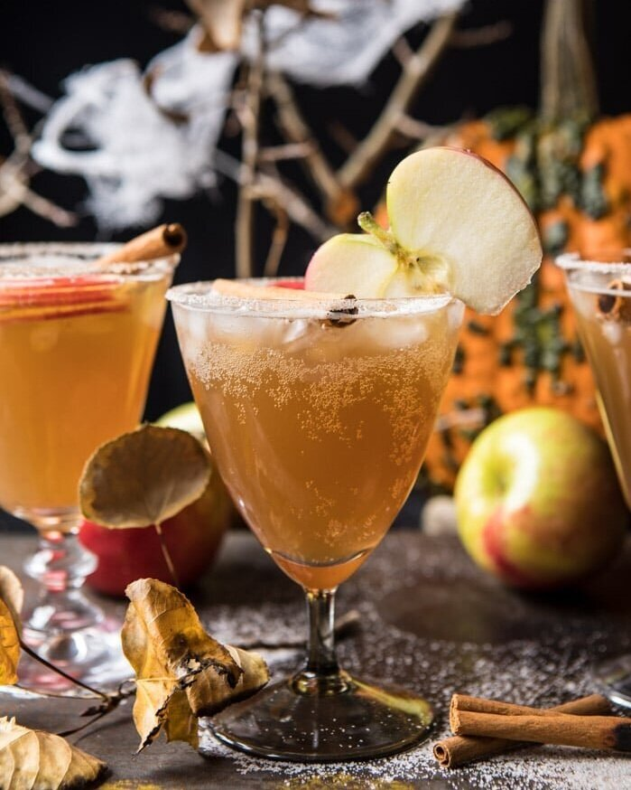 4. Haunted Orchard Cocktail - The Haunted Orchard Cocktail was inspired by the Legend of Sleepy Hallows. Combine tequila, a splash of lemon, apple cider, a teensy bit of maple syrup, ginger and cinnamon in a glass then top with sparkling hard cider. A punch style drink it's easily serves a crowd!