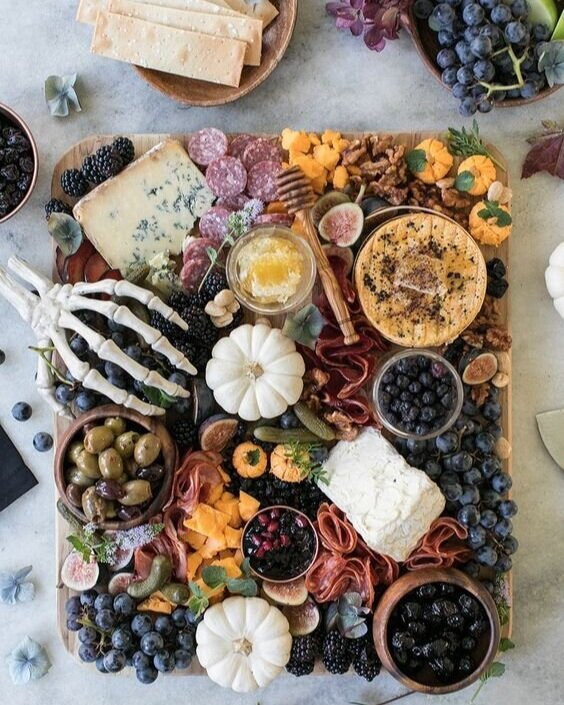 8. Perfectly Spooky Charcutrie Board - We here at F10 think that charcuterie boards are always a good idea. Combine your favorite fruits, vegetables, cheeses and cured meats with some beautiful gourds and that spare skeleton hand you have lying around and you're all set.