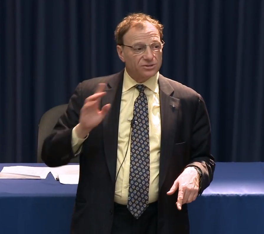 The lobbyist  Hank Sheinkopf  spoke at a lecture at CUNY Queensborough in 2010. He refused to answer questions by the Office of the Inspector General about the AEG bidding process. Mr. Sheinkopf was hired to represent AEG as a lobbyist. Source : CUNY Queensborough/YouTube Screenshot