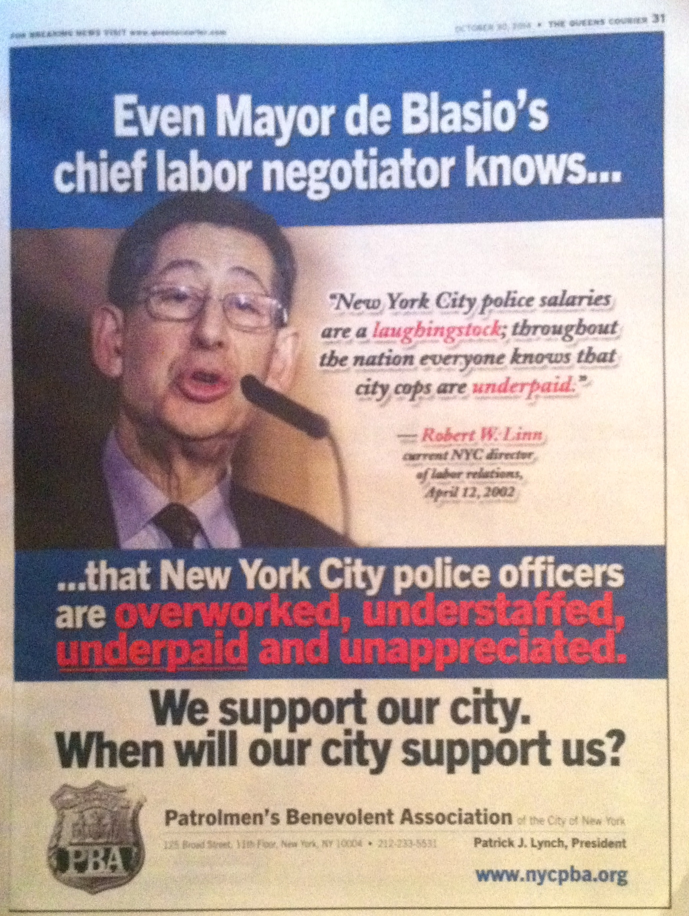 A full-page advertisement in the Oct. 30, 2014 edition of  The Queens Courier .  The  Patrolemen's Benevolent Association  is waging a public relations war with the de Blasio administration over a new  union contract .  Source :   The Queens Courier /Photograph by Progress Queens