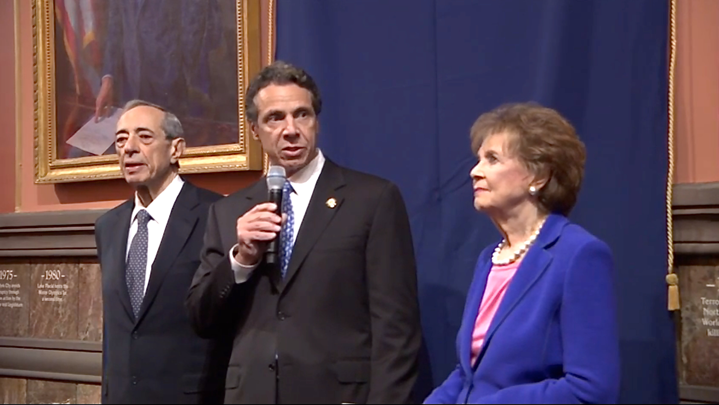 Former Governor Mario Cuomo, left, Governor Andrew Cuomo, center, and former First Lady Matilda Cuomo, right, in a reception before the unveiling of the official portrait ofthe elder Governor Cuomo. Source : New York State Executive Chamber/YouTube Screen Shot