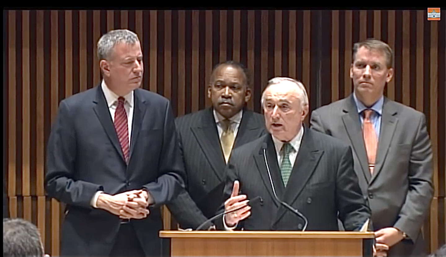 """At a press conference Monday at One Police Plaza with Mayor  Bill de Blasio  at his side, NYPD Commissioner  William Bratton  said that, """" Broken Windows  is here to stay.  Stop, question, and frisk  is here to stay."""" Source : NYC Mayor's Office/YouTube Screen Shot"""