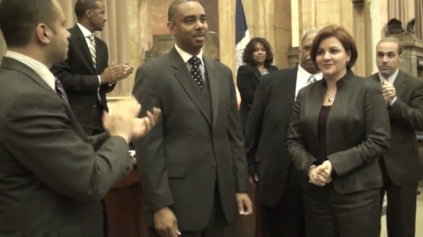 Councilmember  Ruben Wills  (D-Jamaica), center, with former Council Speaker  Christine Quinn  (D-West Village) in 2010 on the day Councilmember Wills was sworn into office. Source : New York City Council/YouTube Screen Shot
