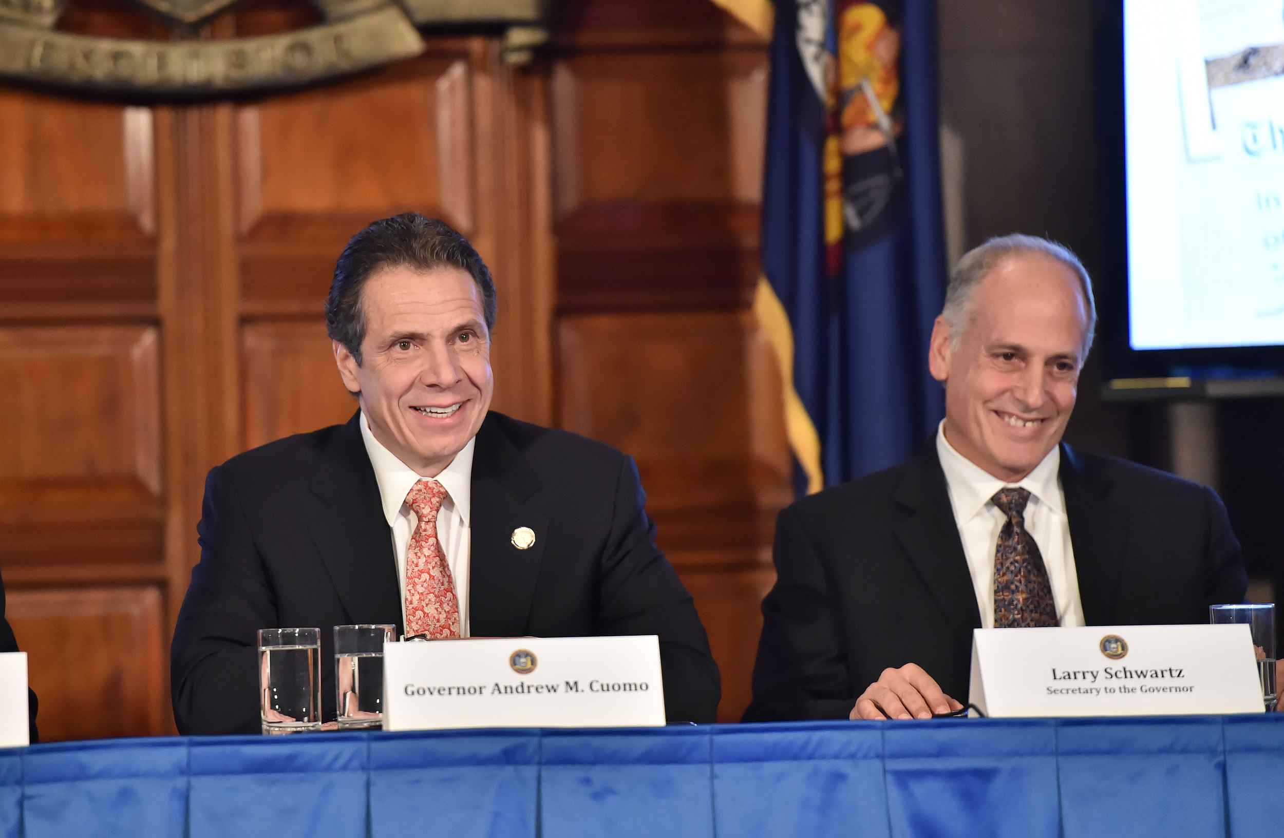 Governor  Andrew Cuomo , left, with his former secretary,  Lawrence Schwartz , at a cabinet meeting onDecember 17, 2014. Mr. Schwartz had disappeared from the public after Governor Cuomo's office announced on January 11, 2015, that Mr. Schwartz was going to depart for the private sector. However, a bombshell report published by  Fredric Dicker  in  The New York Post  revealed that Governor Cuomo had misrepresented the truth about Mr. Schwartz's whereabouts. Source : Official Photograph/Kevin P. Coughlin,Office of the Governor/Flickr