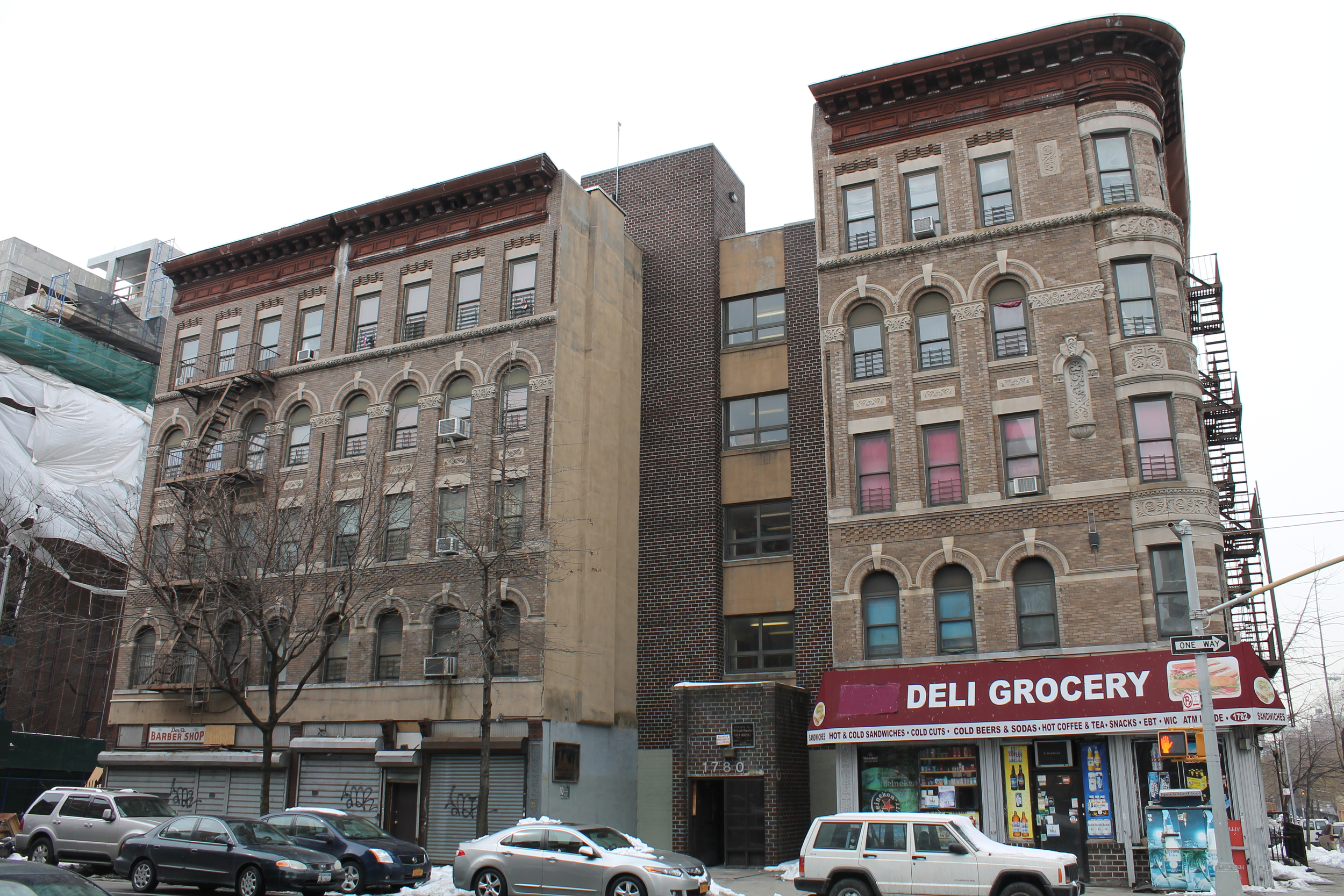 1780 Madison Avenue, at left, whose ground-floor retail spaces have been vacated, and 1782 Madison Avenue, at right, as seen on March 3, 2015. The buildings had recently been refurbished by NYCHA. Source : Louis Flores