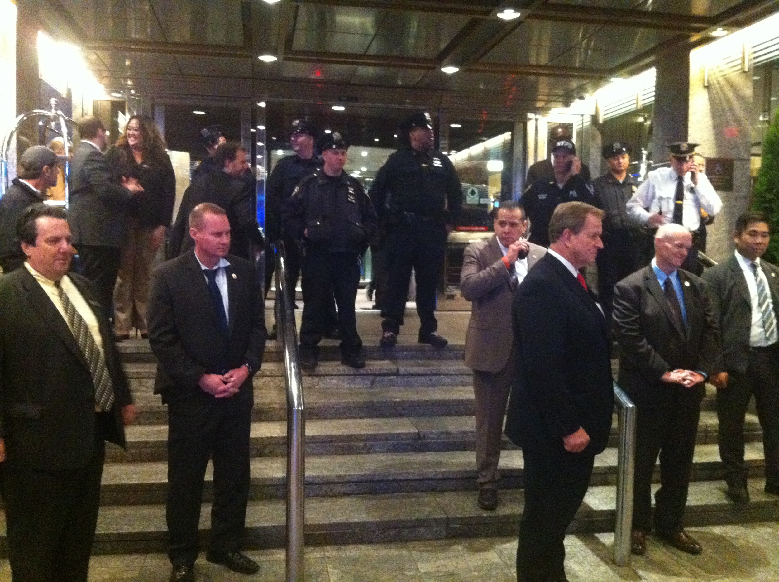 After  activists  rushed the main entrance to the  Sheraton , the site of Mayor  Bill de Blasio 's fundraiser,  NYPD  officers blocked the entrance, placing he main entrance on temporary  lockdown .  Source :  Louis Flores/Progress Queens