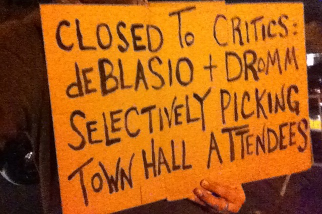 A protest sign carried by the publisher of Progress Queens outside P.S. 69, the site of Mayor Bill de Blasio's town hall. Source : Louis Flores/Progress Queens