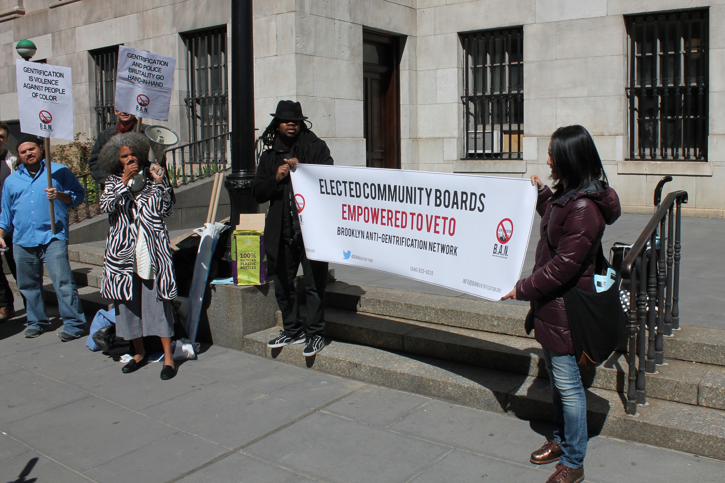 Activists and New York City residents participated in a press conference and community speak-out on Wednesday outside Brooklyn Borough Hall to demand reforms to the Community Board system of New York City government. Source : Louis Flores