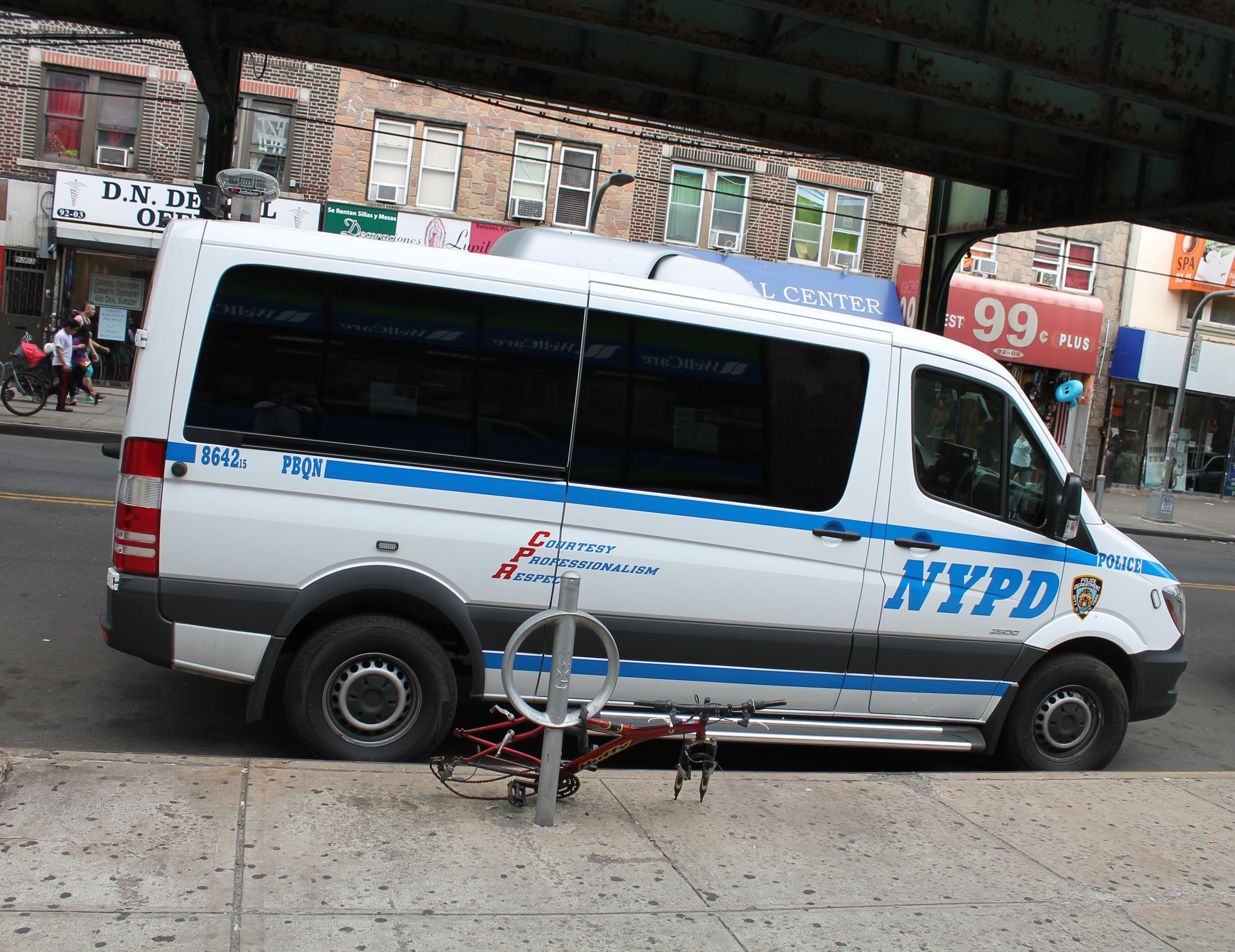 One of three NYPD vehicles parked outside the offices of Make the Road New York on Monday afternoon. Source : Louis Flores/Progress Queens