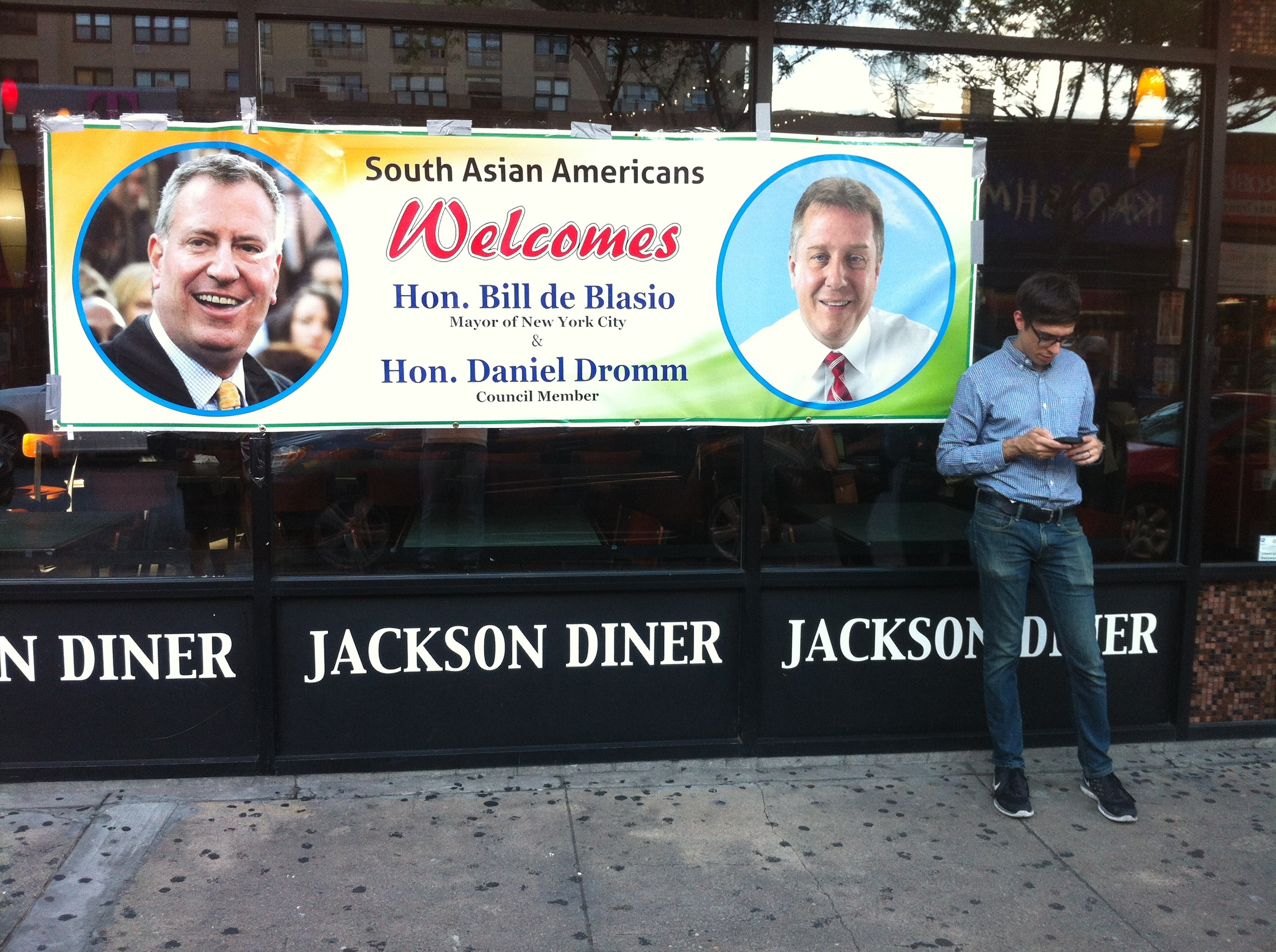 The giant welcoming banner outside the  Jackson Diner , location of a small money donation fundraiser to benefit the  committee to reëlect  Mayor  Bill de Blasio  (D-New York City). The fundraiser was hosted by New York City Councilmember  Daniel Dromm  (D-Jackson Heights). Source : Louis Flores/Progress Queens