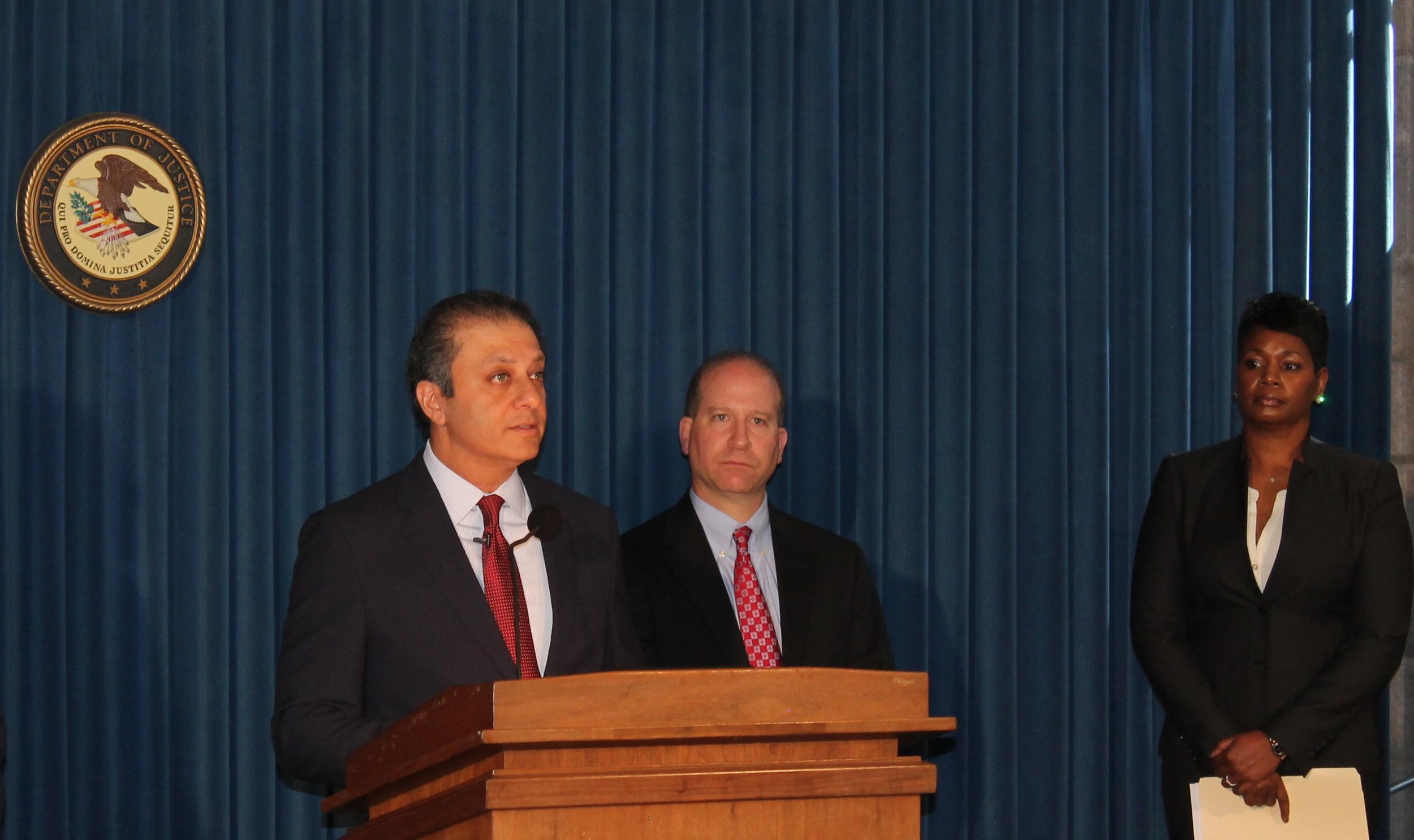 At a press conference announcing Federal criminal charges against nine (9) loyalists to the Cuomo administration were (Left to Right) : U.S. Attorney  Preet Bharara , the nation's top Federal prosecutor in New York's southern district ;  Adam Cohen , the federal bureau of investigation special agent in charge of the Buffalo Field Office ; and  Shantelle Kitchen , the special agent in charge of the New York Field Office of the Internal Revenue Service-Criminal Investigation. Source : Louis Flores/Progress Queens