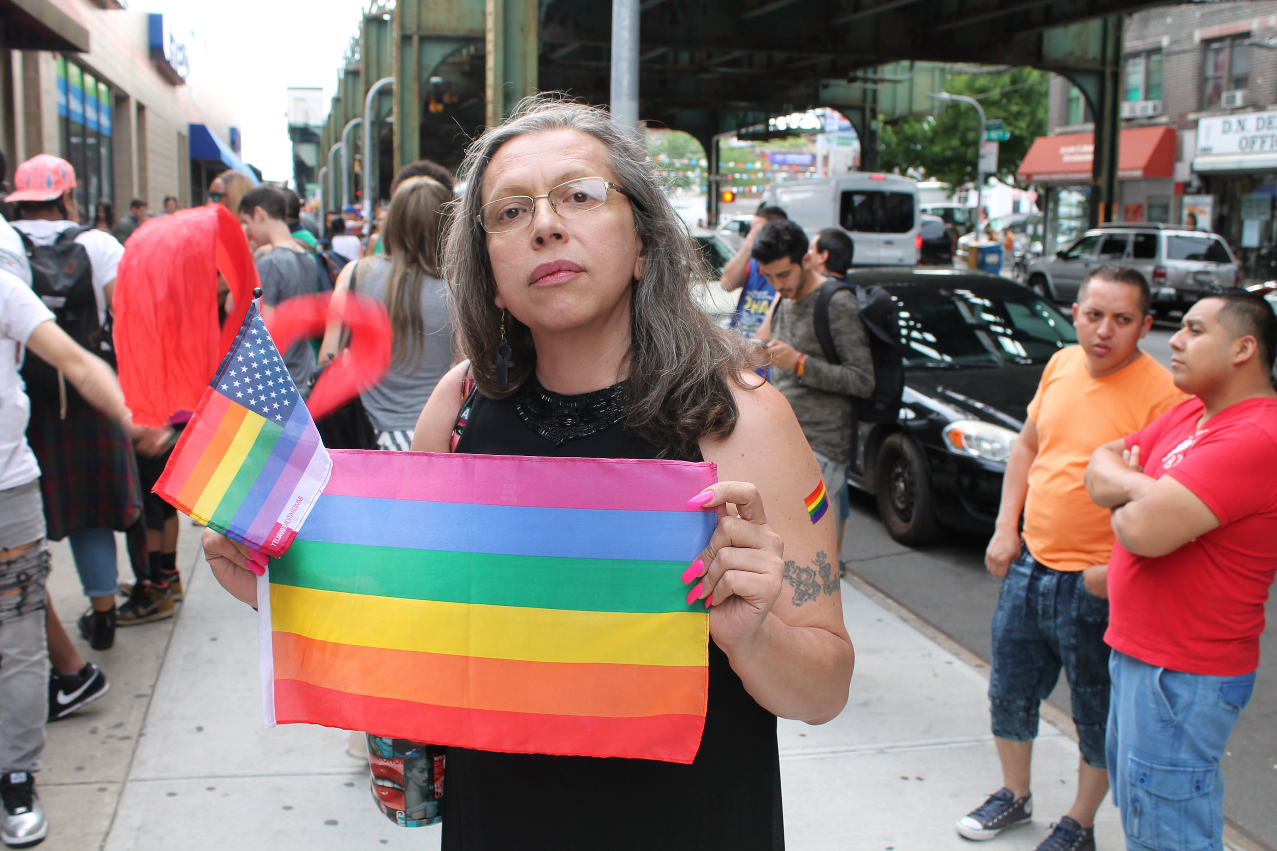 Brooke Cerda Guzmán  in Jackson Heights, Queens, in 2016, at a community event following the massacre at the  Pulse night club  in Orlando, Florida. Source : Louis Flores/Progress Queens