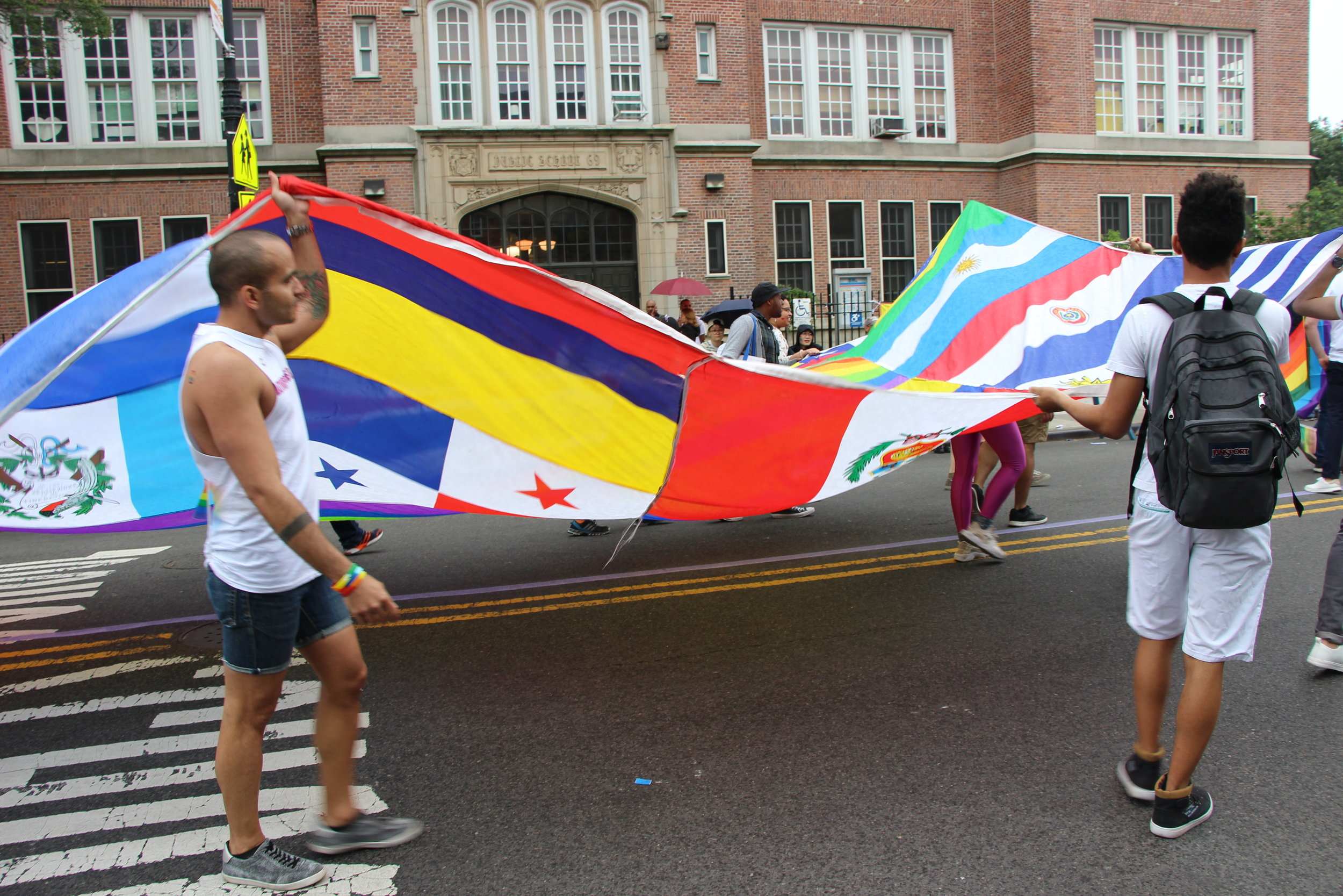 Another view of the giant patchwork of flags. As noted in the 2010 report in  The New York Times , the Queens Pride House has provided services to Queens' immigrant community. Source : Pauline Park/Used With Permission