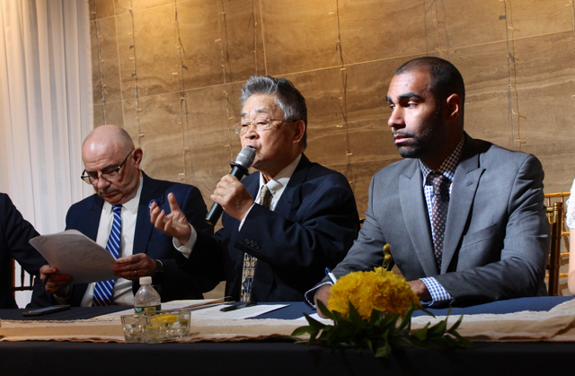 Sung Soo Kim , centre, an advocate for the commercial rent regulation protections for small businesses, said he blamed politicians for failing to provide economic justice to small business owners facing relentless rent increases from commercial landlords.  Source :  Louis Flores/Progress Queens