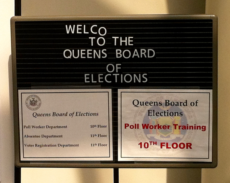 The welcome sign outside the ground floor offices of the Queens Borough Office of the New York City Board of Elections on Queens Boulevard. Source : Louis Flores/Progress Queens
