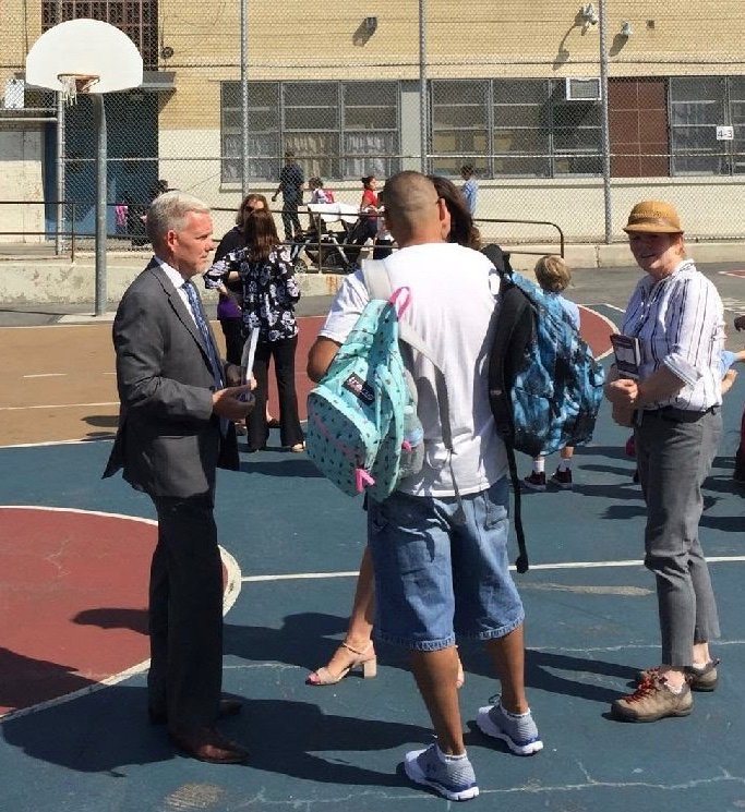 On Monday, 11 September, New York City Councilmember Jimmy Van Bramer, left, was campaigning with Councilmember Elizabeth Crowley, in the background, at Queens PS 229 in Woodside. Source : Kim Caruana/Used With Permission