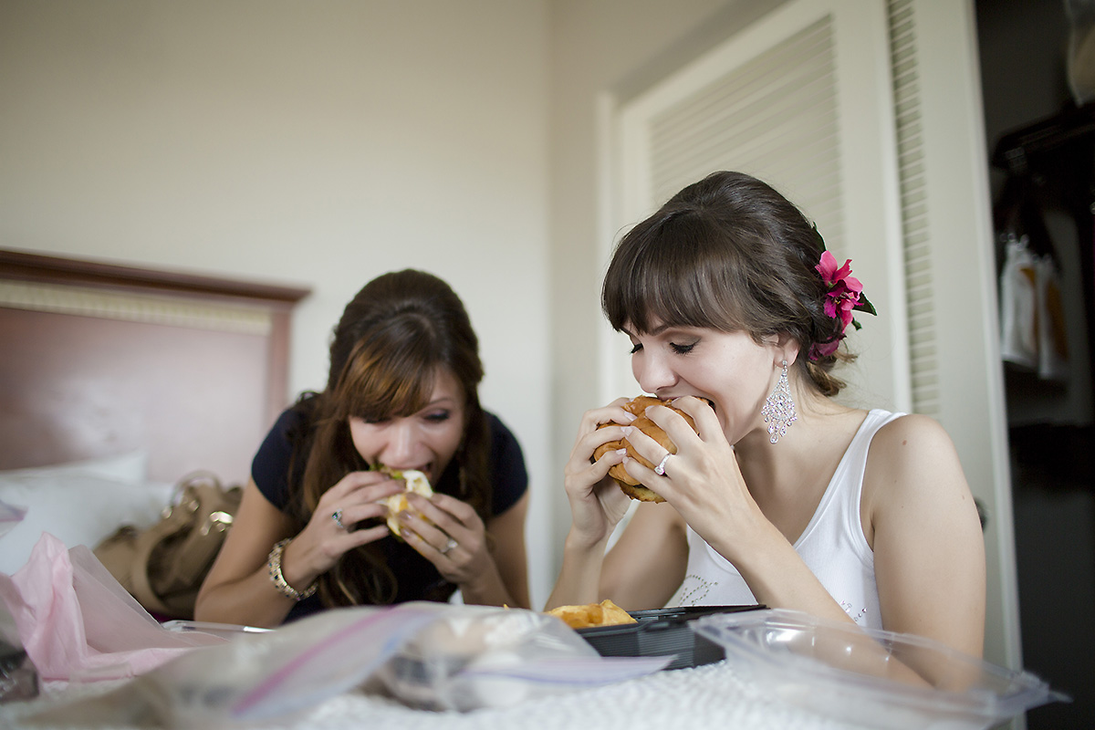 Beautiful bride-to-be Missy (at right) and her sister chow down on burgers before getting dressed!   See their gallery here!