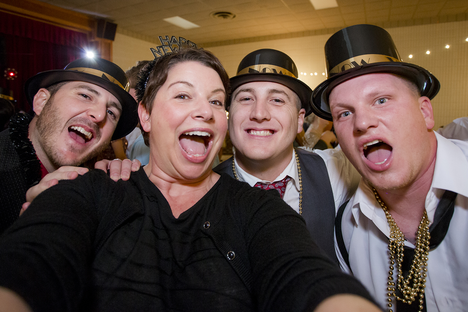 That's me, second from left, celebrating a New Year's Eve wedding with Leslie & Jonathan. And it's a real selfie taken with a real camera. If you're not having fun with your photos, you're doing it wrong.