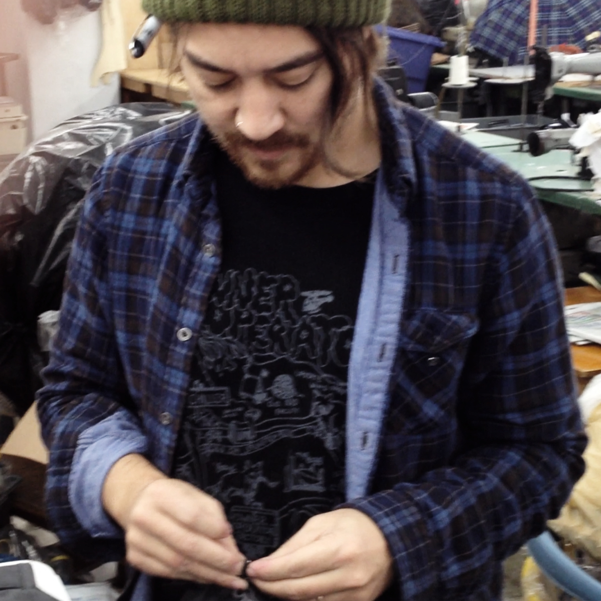 Steven knotting zipper pulls in the factory, NYC 2011
