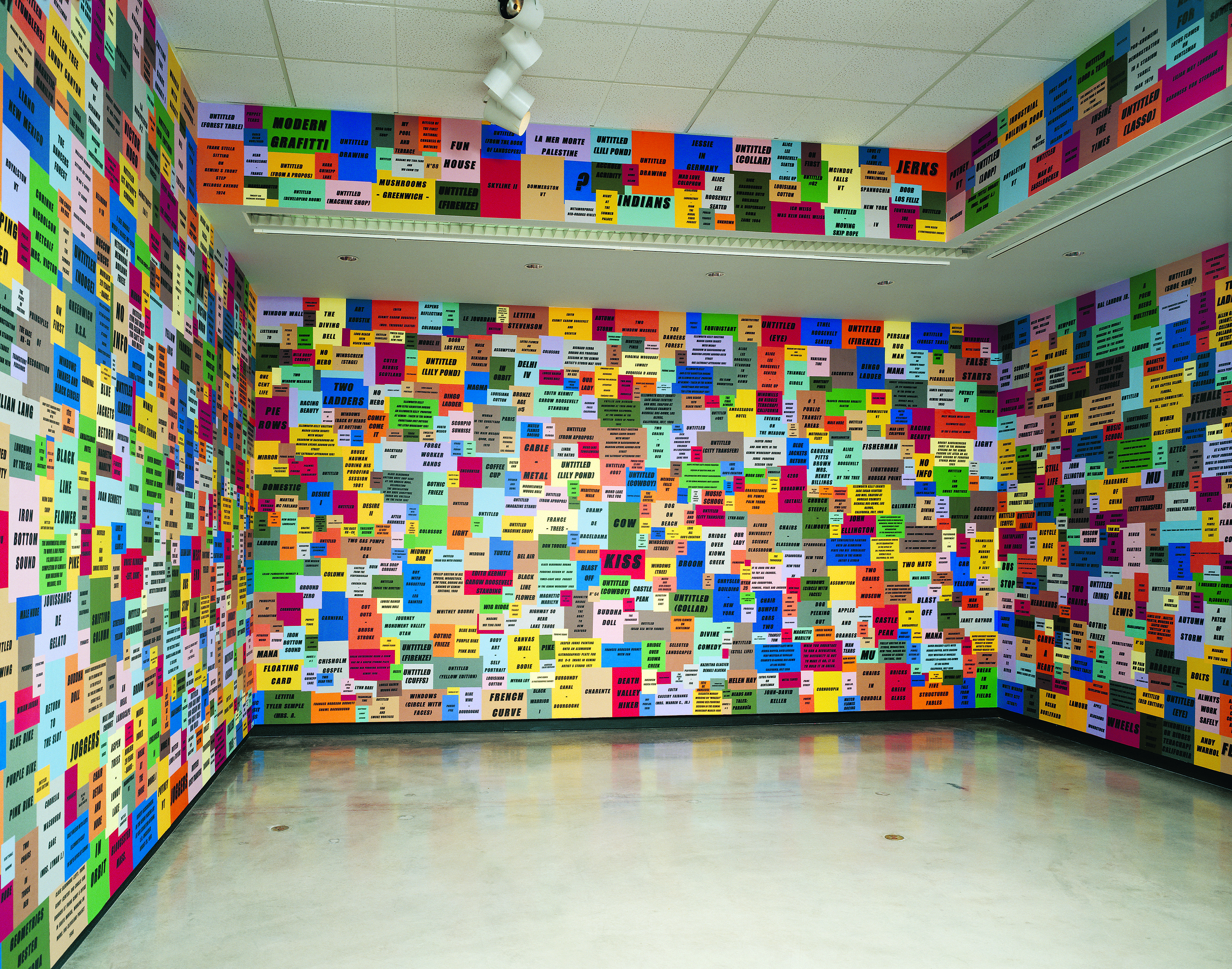 A COLLECTION (1996) SHEETS OF PAPER PASTED ON A WALL